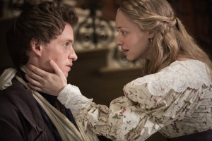 "Marius (EDDIE REDMAYNE) seeks comfort in Cosette's (AMANDA SEYFRIED) arms in ""Les Misérables"" ©Universal Studios. CR: James Fisher."