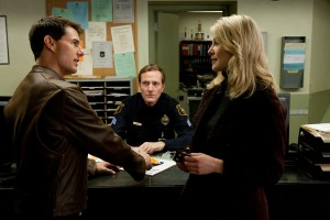 (Left to right) Tom Cruise is Reacher, Lee Child is desk sergeant and Rosamund Pike is Helen in JACK REACHER. ©Paramount Pictures. CR: Karen Ballard.