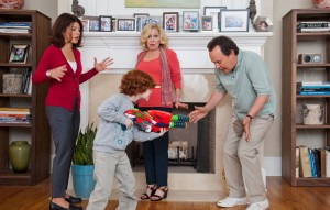 "Artie (Billy Crystal) reacts to grandson Barker's (Kyle Harrison Breitkopf) water-rifle shenanigans, as mom Alice (Marisa Tomei) and grandma Diane (Bette Midler) look on in ""PARENTAL GUIDANCE."" ©20th Century Fox/Walden Media. CR: Phil Caruso."