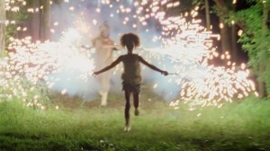 "Quvenzhane Wallis as ""Hushpuppy"" enjoys the lights of sparklers in ""BEASTS OF THE SOUTHERN WILD."" ©20th Century Fox. CR: Ben Richardson."