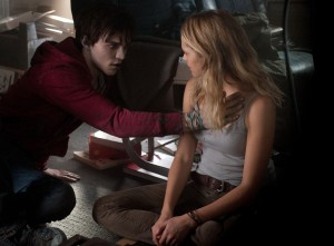 "NICHOLAS HOULT feels the heartbeat of TERESA PALMER star in ""WARM BODIES."" ©Summit Entertainment. CR Jonathan Wenk."