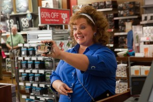"MELISSA MCCARTHY presents her fake identification card whil making a purchase in ""IDENTITY THIEF."" ©Universal Pictures. CR: Bob Mahoney."