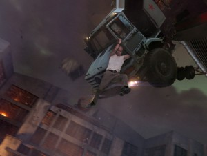 "John McClane (Bruce Willis) keeps on truckin' in ""A GOOD DAY TO DIE HARD."" ©20th Century Fox."