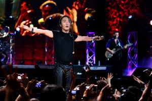 "Arnel Pineda woos the crowd in Manila as he performs with Journey in ""Don't Stop Believin': Everyman's Journey."" ©Ferdie Arquero & Nomota LLC."