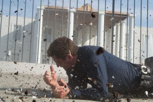 "Gerard Butler braces himself for explosions in ""Olympus Has Fallen."" ©Film District. CR: Phil Caruso."