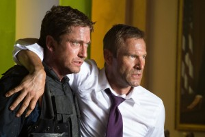 "Gerard Butler (left) helps Aaron Eckhart in ""Olympus Has Fallen."" ©Film District. CR: Phil Caruso."