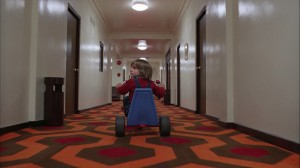 "Danny Lloyd rides his tricylce past Room 237 in ""The Shining."" ©Warner Bros. Pictures."