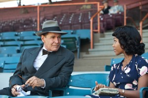 "(L-r) HARRISON FORD as Branch Rickey and NICOLE BEHARIE as Rachel Robinson in ""42."" ©Warner Bros. Entertainment. CR: D. Stevens."