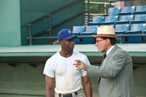 "(L-r) CHADWICK BOSEMAN as Jackie Robinson and HARRISON FORD as Branch Rickey in ""42."" ©Warner Bros. Entertainment/Legendary Pictures Productions. CR: D Steven"