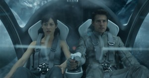 "Julia (OLGA KURYLENKO) and Jack (TOM CRUISE) hurtle through the air in the Bubbleship in ""Oblivion."" ©Universal Pictures."