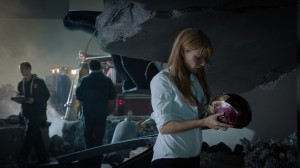 "Pepper Potts (Gwyneth Paltrow) examines Iron Man's helmet in ""Marvel's Iron Man 3"" © 2012 MVLFFLLC.  TM & © 2012 Marvel. CR: Zade Rosenthal."