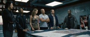 "(L to R) Han (SUNG KANG), Tej (CHRIS ""LUDACRIS"" BRIDGES), Gisele (GAL GADOT), Dom (VIN DIESEL), Brian (PAUL WALKER) and Roman (TYRESE GIBSON) get back behind the wheel in ""Fast & Furious 6."" © 2013 Universal Studios"