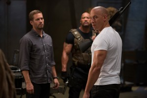 "(L to R) Brian (PAUL WALKER), Hobbs (DWAYNE JOHNSON) and Dom (VIN DIESEL) reunite for ""Fast & Furious 6."" ©Universal Studios. CR: Giles Keyte."