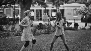 "(l-r) Greta Gerwig & Mickey Sumner playfighting in ""Frances Ha."" ©Pine District, LLC."