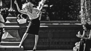 "Greta Gerwig dancing in front of fountain in ""Frances Ha.""  ©Pine District, LLC."