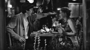 "(l-r) Adam Driver with Greta Gerwig having dinner in ""Frances Ha."" ©Pine District, LLC"