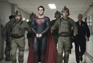 "HENRY CAVILL (center) as Superman and CHRISTOPHER MELONI (far right) as Colonel Nathan Hardy in Warner Bros. Pictures' and Legendary Pictures' action adventure ""MAN OF STEEL."" ©DC Comics/Warner Bros. Entertainment. CR: Clay Enos."