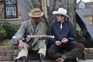 "Old friends catch up on the streets of Montgomery, AL. - Lawrence Hamilton (l) and Henry Thomas (r) as HANK WILLIAMS in ""THE LAST RIDE [Harry Thomason, Director / James Roberson, Cinematographer] ."" ©Live Bait Productions/Mozark Productions. CR: Melody Gaither."