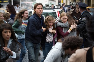 "Left to right: Brad Pitt is Gerry Lane, Abigail Hargrove is Rachel Lane, and Mireille Enos is Karin Lane in ""WORLD WAR Z."" ©Paramount Pictures. CR: Jaap Buitendijk."