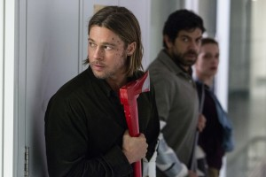 (l-r) Brad Pitt, Pierfrancesco Favino and Daniella Kertesz aren't hunting for trees with that ax in WORLD WAR Z. ©Paramount Pictures. CR: Jaap Buitendijk.