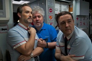 "Left to right: Javier Cámara, Pedro Almodóvar and Carlos Areces in ""I'm  So Excited!"" ©Sony Pictures Classics. CR: Paola Ardizzoni/Emilio Pereda/ Sony Pictu"