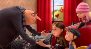 "(L to R) Gru (STEVE CARELL) has a family meeting with Margo (MIRANDA COSGROVE), Edith (DANA GAIER) and Agnes (ELSIE FISHER) in ""Despicable Me 2."" ©Universal Studios."