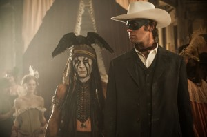 "L to R: Johnny Depp as Tonto and Armie Hammer as The Lone Ranger in ""THE LONE RANGER."" ©Disney Enterprises/Jerry Bruckheimer Inc. CR: Peter Mountain."