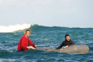 "(l-r) Andy (Myles Pollard) and JB (Sam Worthington) keep on the lookout for JImmy (Xavier Samuel) as he tries to catch a wave in ""Drift."" ©Lionsgate Entertainment."
