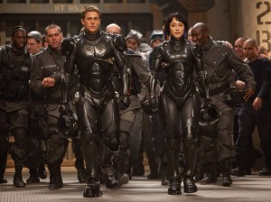 "(l-r) Raleigh Beckett (Charlie Hunnam) and Mako Mori (Rino Kikuch) get ready for battle in ""Pacific Rim."" ©Warner Bros. Entertainment/Legendary Pictures Funding. CR: Kerry Hayes."