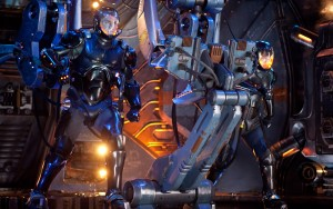 "(l-r) Raleigh Beckett (Charlie Hunnam) and Mako Mori (Rino Kikuch) control their robot for battle in ""Pacific Rim."" ©Warner Bros. Entertainment/Legendary Pictures Funding. CR: Kerry Hayes."