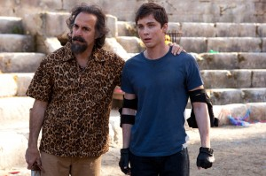 "(L-R) Dionysus (Stanley Tucci) takes Percy (Logan Lerman) under his wing IN ""Percy Jackson: Sea of Monsters."" ©20th Century Fox. CR:Murray Close."