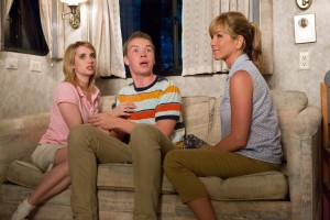 "(l-r) EMMA ROBERTS as Casey Mathis, WILL POULTER as Kenny Rossmore and JENNIFER ANISTON as Rose O'Reilly in ""WE'RE THE MILLER."" ©Warner Bros. Entertainment. CR: MIchael Tackett."