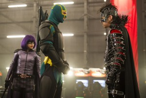 "(L to R) Hit Girl (CHLOË GRACE MORETZ) and Kick-Ass (AARON TAYLOR-JOHNSON) face off against The Mother F%&*^r (CHRISTOPHER MINTZ-PLASSE) in the follow-up to 2010's irreverent global hit: ""Kick-Ass 2"". ©Universal Studios. CR: Daniel Smith."