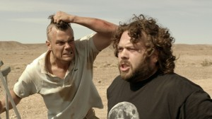 "(L-R) Josh Duhamel can't keep his cool with Dan Fogler in the unique character-driven thriller ""SCENIC ROUTE."" ©Vertical Entertainment."