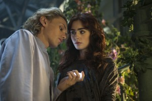 (l-r) Jace (Jamie Campbell Bower) tells (Lily Collins) about his childhood in Screen Gems fantasy-action THE MORTAL INSTRUMENTS: CITY OF BONES. ©Constantin Film International GmbH and Unique Features (TMI) Inc. CR: Rafy.