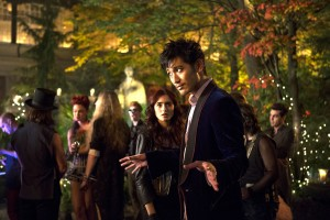 "(l-r) Clary (Lily Collins) watches as Magnus Bane (Godfrey Gao) greets his guests in Screen Gems fantasy-action ""THE MORTAL INSTRUMENTS: CITY OF BONES."" ©Constantin Film International GmbH and Unique Features (TMI) Inc. CR: Rafy."