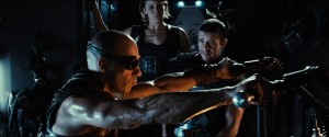 "(L to R) Riddick (VIN DIESEL) is forced to work with mercs Dahl (KATEE SACKHOFF) and Boss Johns (MATT NABLE) in ""Riddick"", the latest chapter of the groundbreaking saga that began with the hit sci-fi film ""Pitch Black"". ©Universal Studios."