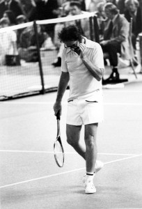Bobby Riggs walks off the court near the end of the third match in which Billie Jean King defeated the one-time champion of the courts to take the $100,000 winner-take-all tournament at the Houston Astrodome, Texas, on Sept. 20, 1973. King won 6-4, 6-3, 6-3. ©AP.