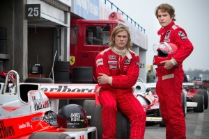 "(L to R) CHRIS HEMSWORTH as the charismatic Englishman James Hunt and DANIEL BRÜHL as disciplined Austrian perfectionist Niki Lauda in ""Rush."" ©Universal Studios. CR: Jaap Buitendijk."