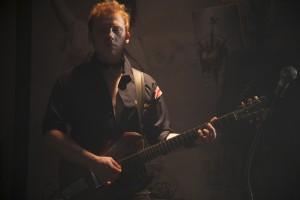 "Rupert Grint with guitar in ""CBCG."" ©XLrator Media. CR: Beau Giann."