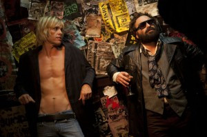 "(l-r) Iggy (Taylor Hawkins) looks at Terry (Jonathan Galecki) in ""CBGB."" ©XLrator Media. CR: Beau Giann."