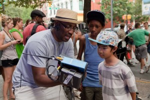 "(l-r) Director George Tillman Jr, Skylan Brooks and Ethan Dizon on the set of ""The Inevitable Defeat of Mister and Pete."" ©Lionsgate Entertainment."