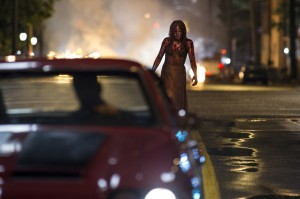 Chloe Moretz and Alex Russell (in car) in Metro-Goldwyn-Mayer Pictures and Screen Gems' horror thriller CARRIE. ©Metro-Goldwyn-Mayer/Screen Gems.