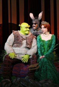 "(l-r): Brian d'Arcy James (Shrek), Daniel Breaker (Donkey), & Sutton Foster (Princess Fiona) in ""Shrek: The Musical."" ©DreamWorks Theatricals. CR: Joan Marcus."