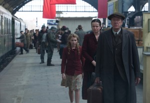 "Liesel (Sophie Nélisse) meets her new foster parents, Hans (Geoffrey Rush) and Rosa (Emily Watson) in ""The Book Thief."" ©20th Century Fox. CR: Jules Heath."