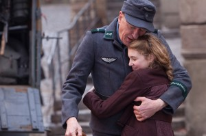 "Liesel (Sophie Nélisse) and her foster father Hans (Geoffrey Rush) share a quiet moment in ""The Book Thief."" ©20th Century Fox. CR: Jules Heath."