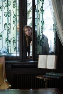 "Liesel (Sophie Nélisse) sneaks into a neighbor's well-stocked library to pursue her love of reading in ""The Book Thief."" ©20th Century Fox. CR: Jules Heath."