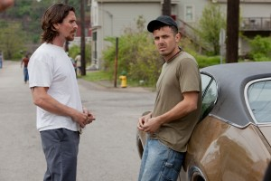 "(Left to right.)  Stars Christian Bale and Casey Affleck in Relativity Media's ""Out of the Furnace."" © 2012 Relativity Media. CR: Kerry Hayes."