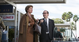 "P.L. Travers (Emma Thompson) and Ralph (Paul Giamatti), in Disney's ""Saving Mr. Banks."" ©Disney Enterprises. CR: Francois Duhamel."