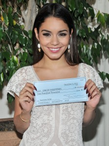 Vanessa Hudgens accepting on behalf of UNICEF Philippines, the $100,000 donation check by the Hollywood Foreign Press Association (HFPA) to help in the Typhoon Haiyan relief efforts held at the Hollywood Foreign Press Association in West Hollywood, CA. The event took place on Thursday, December 12, 2013. Photo by Sthanlee B. Mirador_GMA | Pacific Rim Photo Press.